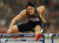 This file photo, taken on May 19, shows Liu Xiang of China winning the men&#39;s 110m hurdle event during the Diamond League athletics meet in Shanghai. Liu plans to celebrate his birthday by sending a warning to his Olympic rivals on his first appearance at the London Grand Prix on Friday