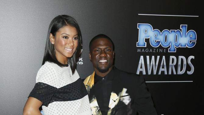 Actor Kevin Hart and Eniko Parrish arrive at the People Magazine Awards in Beverly Hills