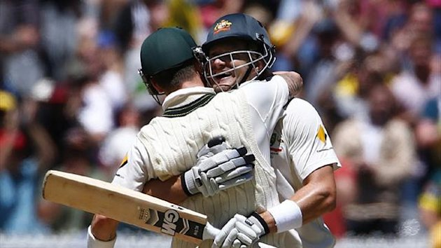 Australia's Shane Watson and Chris Rogers celebrate in Melbourne (Reuters)