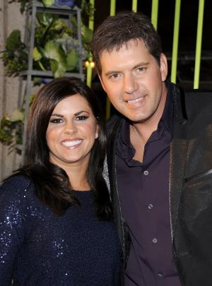 FILE - In this Nov. 8, 2011 file photo, Rodney Atkins, right, and his wife Tammy Jo arrive at the 59th Annual BMI Country Awards in Nashville. Atkins will not be prosecuted on a misdemeanor domestic assault charge if he continues to meet court-ordered conditions. Atkins was arrested last November at his home in Brentwood after his wife Tammy Jo Atkins told police he attacked her and tried to suffocate her with a pillow after a night of drinking. A Tennessee judge on Wednesday, Feb. 8, 2012, agreed to retire the charge, meaning it will be removed from Atkins' record if he stays out of trouble for 11 months and 29 days and completes 30 hours of community service. (AP Photo/Evan Agostini, file)