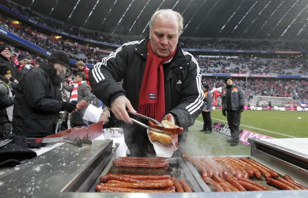 File photo of Bayern Munich's President Hoeness barbecuing sausages for supporters before Bundesliga soccer match against Hertha Berlin in Munich