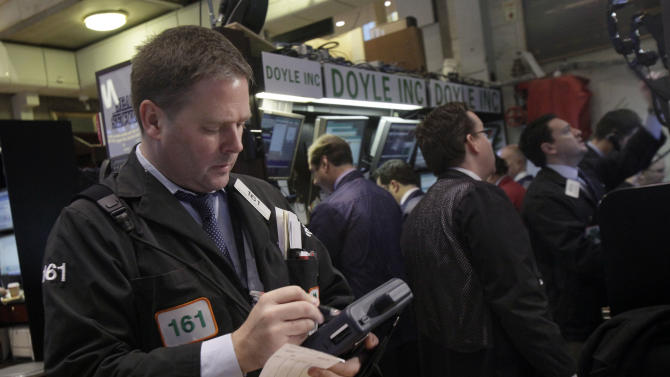 Trader Thomas McCauley, left, works on the floor of the New York Stock Exchange Thursday, Dec. 6, 2012.  The U.S. stock market wobbled between small gains and losses in early trading Thursday. (AP Photo/Richard Drew)