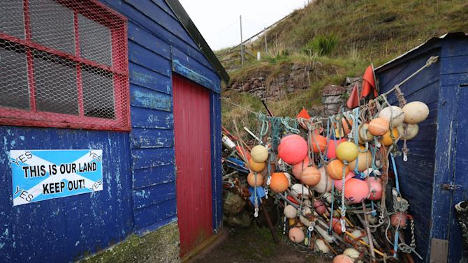 "A ""Yes"" sign is displayed on a fisherman's shack in St Abbs, Scotland, Tuesday, Sept. 16, 2014. The two sides in Scotland's independence debate are scrambling to convert undecided voters, with just two days to go until a referendum on separation. (AP Photo/Scott Heppell)"