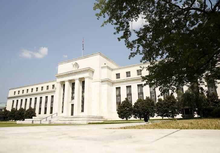 Fed awaiting evidence global chill not knocking U.S. off track