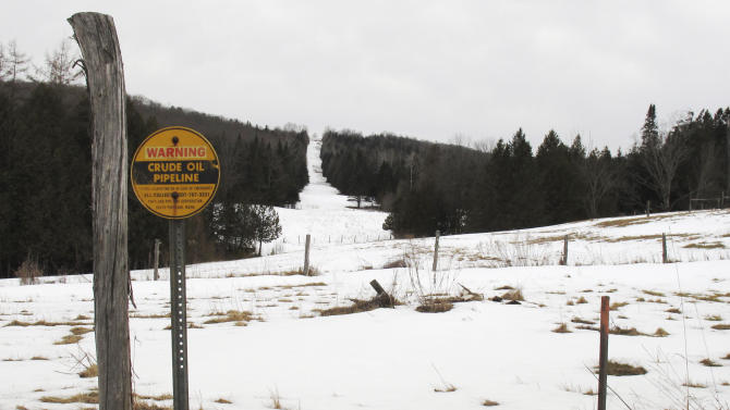 In this Monday, March 11, 2013 photo, a sign indicates a section of a buried crude oil pipeline in Burke, Vt. Canadian energy officials insist they have no plans to reverse the flow of the pipeline that now carries crude oil from Maine to Montreal, but that has done little to reassure New England towns that are against the idea and the 18 members of Congress asking for a full environmental review. (AP Photo/Wilson Ring)