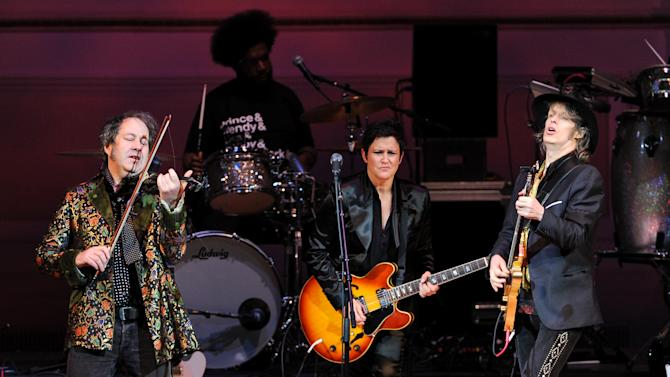 """Musicians Steve Wickham, left, and Mike Scott from The Waterboys perform with guitarist Wendy Melvoin, center, at """"The Music of Prince"""" tribute concert at Carnegie Hall on Thursday March 7, 2013 in New York. (Photo by Evan Agostini/Invision/AP)"""