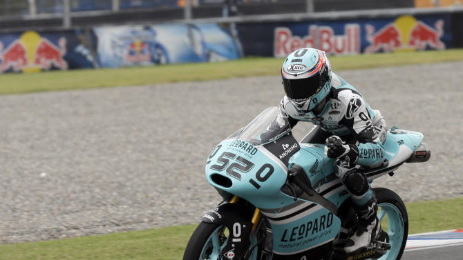 Great Britain's Danny Kent celebrates after crossing the finish line first as he rides his Honda during the Moto3 race of Argentina's Motorcycle Grand Prix at the Termas de Rio Hondo circuit in Argentina,  Sunday, April 19, 2015. (AP Photo/Natacha Pisarenko)