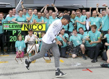 Mercedes drivers Hamilton and Rosberg celebrate with team after Austrian F1 Grand Prix in Spielberg