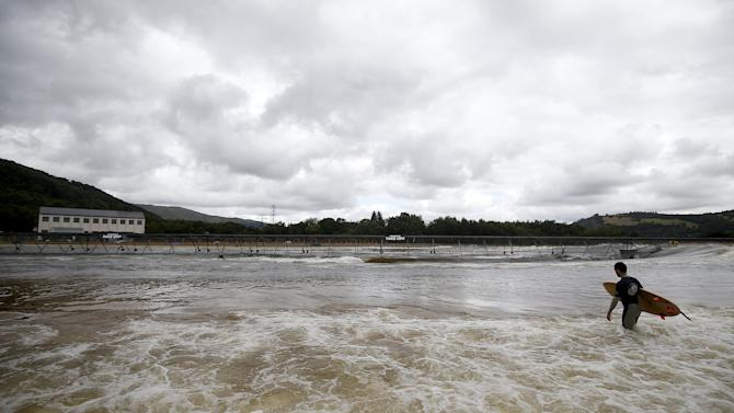 Surfers surf at Surf Snowdonia in Conwy