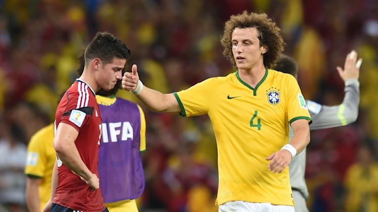 Colombia's James Rodriguez (left) is comforted by Brazil's David Luiz after the World Cup quarter-final at the Castelao Stadium in Fortaleza, on July 4, 2014