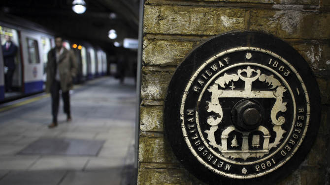 In this photo taken Tuesday, Jan. 8, 2013, a commemorative sign detailing when the station was opened and refurbished, displayed at Baker Street underground station in London. The world's first subway system marked its 150th anniversary Wednesday,  Jan. 9, 2013, with reports showing conditions way back when were much as they are today: Busy, congested and stressful for passengers.   (AP Photo/Alastair Grant)