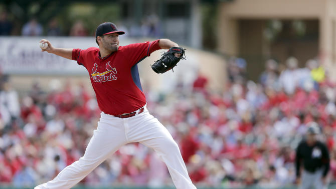 FILE - In this March 8, 2015, file photo, St. Louis Cardinals starting pitcher Lance Lynn throws during a spring training baseball game against the Miami Marlins in Jupiter, Fla. Lynn is scheduled to start for the Cardinals on Thursday, April 2, against the New York Mets in the teams' final game of spring training. (AP Photo/Jeff Roberson, File)