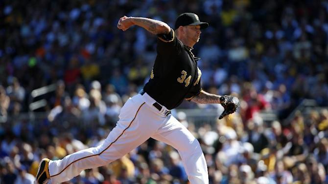 Pittsburgh Pirates starting pitcher A.J. Burnett (34) drivers in the first inning of a baseball game against the New York Mets in Pittsburgh, Saturday, May 23, 2015. (AP Photo/Gene J. Puskar)