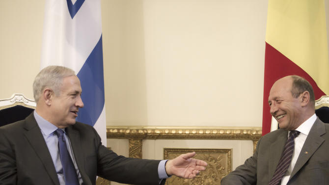 Israeli Prime Minister Benjamin Netanyahu, left, gestures during the meeting with Romanian President Traian Basescu, right,  at the Cotroceni Presidential Palace, in Bucharest, Romania, Wednesday, July 6, 2011. (AP Photo/Vadim Ghirda)