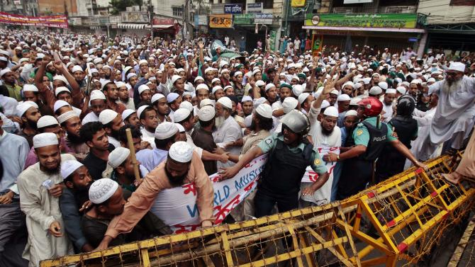 Muslims scuffle with police during a protest against the anti-Islam film which depicts the Prophet Muhammad as a fraud, a womanizer and a madman, in Dhaka, Bangladesh, Friday, Sept. 14, 2012. (AP Photo/A.M. Ahad)