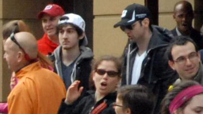 This Monday, April 15, 2013 photo provided by Bob Leonard shows bombing suspects Tamerlan Tsarnaev, 26, center right in black hat, and his brother, Dzhokhar A. Tsarnaev, 19, center left in white hat, approximately 10-20 minutes before the blasts that struck the Boston Marathon. It's a vexing puzzle about the Boston Marathon bombings: The younger of the two accused brothers hardly seemed headed for a monumental act of violence. How could he team up with his older brother to do this? Nobody knows for sure, but some experts in sibling research say the powerful bonds that can develop between brothers may have played a role. (AP Photo/Bob Leonard)