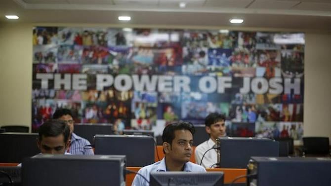 Newly recruited employees attend a training session inside Tech Mahindra office building in Noida on the outskirts of New Delhi March 18, 2013. REUTERS/Adnan Abidi/Files