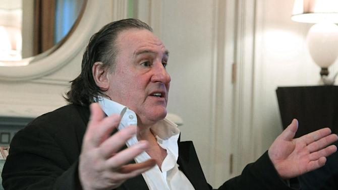 French actor Gerard Depardieu gestures while speaking to Russian President Vladimir Putin, unseen, after his arrival late Saturday, Jan. 5, 2013, at the president's residence in Sochi, the host city of the 2014 Winter Olympics. Depardieu has received a Russian passport after flying to Russia for a late night dinner with Putin. Depardieu sought Russian citizenship as part of his battle against a proposed super tax on millionaires in France, and Putin granted his request last week. (AP Photo/RIA-Novosti, Mikhail Klimentyev, Presidential Press Service)
