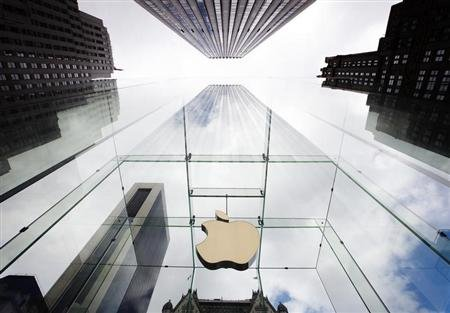 The Apple logo hangs in a glass enclosure above the 5th Ave Apple Store in New York