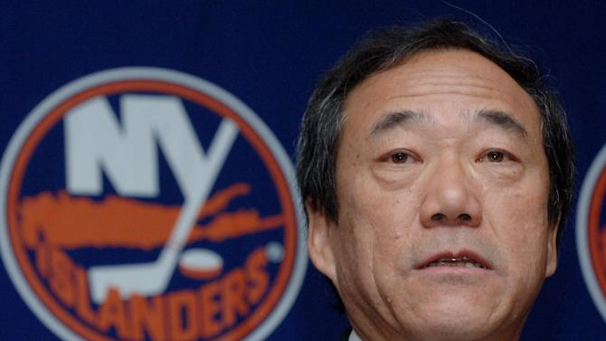 "In this Jan. 12, 2006, file photo, New York Islanders' owner Charles Wang speaks during a news conference in Uniondale, New York. The Islanders have announced that the team is being sold to a former Washington Capitals co-owner and a London-based investor. In a statement Tuesday, Aug. 19, 2014, the team says a group led by former Capitals co-owner Jon Ledecky and investor Scott Malkin has reached an agreement to buy a ""substantial"" minority interest in the team"
