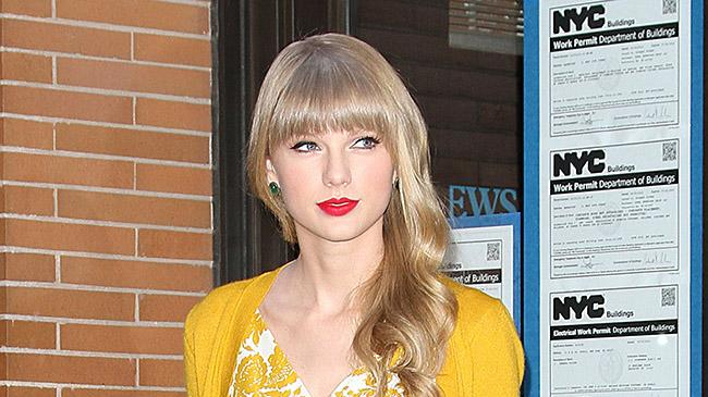 Taylor Swift spotted smiling while she is leaving the katie Couric Show in New York City