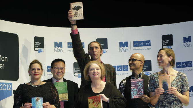 Authors, from left to right, Tan Twan Eng, Deborah Levy, Hilary Mantel, Will Self, holding his book, top, Alison Moore and Jeet Thayil, shortlisted for the Man Booker Prize, hold copies of their books during a photo call at the Royal Festival Hall, in London, Monday Oct. 15, 2012. The 50,000 British pounds (80,000 US dollars approx.) prize will be announced Tuesday, Oct. 16, 2012. (AP Photo/Lefteris Pitarakis)