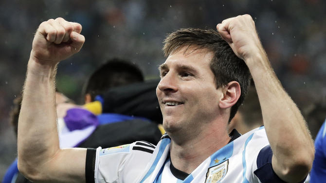 Argentina's Lionel Messi pumps his fists after Argentina defeated the Netherlands 4-2 in a penalty shootout after a 0-0 tie after extra time to advance to the finals after the World Cup semifinal soccer match between the Netherlands and Argentina at the Itaquerao Stadium in Sao Paulo Brazil, Wednesday, July 9, 2014. (AP Photo/Victor R. Caivano)