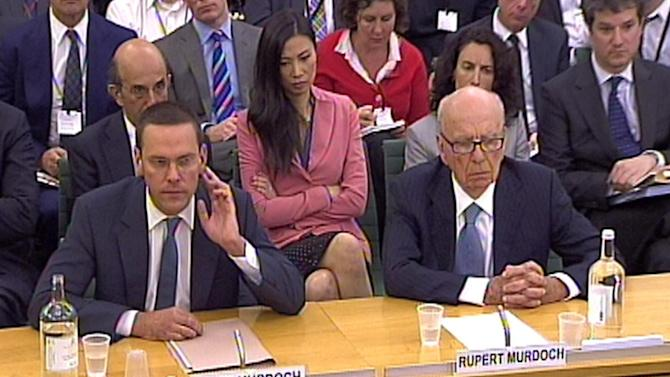 FILE - This is a July 19, 2011 file  photo of James Murdoch, left,  and Rupert Murdoch  giving evidence to the Culture, Media and Sport Select Committee in the House of Commons in central London on the News of the World phone-hacking scandal.  Rupert Murdoch's News Corp. says James Murdoch is stepping down as executive chairman of the company's U.K. newspaper arm. News Corp. said Wednesday Feb. 29, 2012  James Murdoch has relinquished his position at News International to focus on the company's international TV business. (AP Photo/PA, File)  UNITED KINGDOM OUT