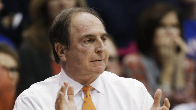 Temple coach Fran Dunphy claps for his team during the first half of an NCAA college basketball game against Kansas in Lawrence, Kan., Sunday, Jan. 6, 2013. (AP Photo/Orlin Wagner)