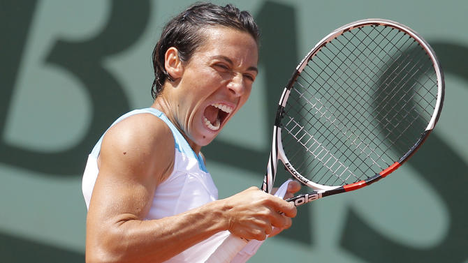 Francesca Schiavone of Italy screams after marking a point in her third round match against Varvara Lepchenko of the U.S. at the French Open tennis tournament in Roland Garros stadium in Paris, Saturday June 2, 2012. (AP Photo/Michel Euler)