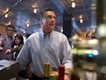 Republican presidential candidate, former Massachusetts Gov. Mitt Romney looks at a menu as he orders dinner at BurgerFi on Sunday, Oct. 21, 2012 in Delray Beach, Fla. (AP Photo/ Evan Vucci)