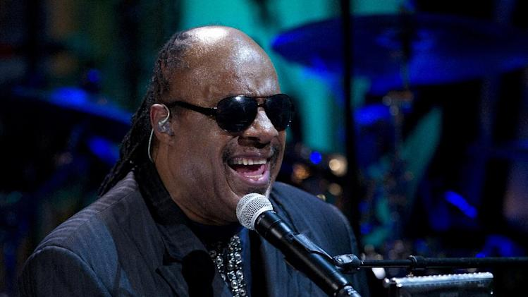 "FILE - In this May 9, 2012 file photo, Stevie Wonder performs during the ""In Performance at the White House"" in the East Room of the White House in Washington, honoring songwriters Burt Bacharach and Hal David. Two people charged with extorting the singer pleaded not guilty Thursday July 26, 2012 and are due back in court in late August for a pretrial hearing. (AP Photo/Carolyn Kaster, File)"