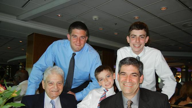 "In this July 22, 2011, photo provided by Joseph Vaglio, right, shows his father Pasquale Vaglio,  left, his grandchildren Joey Vaglio, center, Michael Franza, top left and Brandon Vaglio on board the Royal Caribbean's ""Explorer of the Seas"".  Pasquale Vaglio, a retired New York City policeman and Korean War veteran, was on the cruise with 18 family members. Vaglio hit his head after disembarking on a sightseeing trip in Bermuda. He was examined by the ship's medical unit and told to rest in his cabin. He died a few days later. The Vaglio family has sued the cruise line for medical malpractice and the 11th U.S. Circuit County of Appeals has allowed the suit to move forward in the courts. (AP Photo/Joseph Vaglio)"