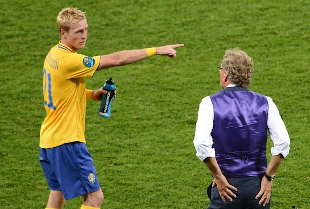 Swedish Midfielder Christian Wilhelmsson (L) Talks AFP/Getty Images