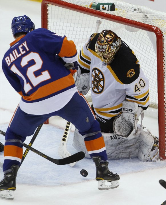 Boston Bruins' Rask makes save against New York Islanders' Bailey during their NHL hockey game in Uniondale