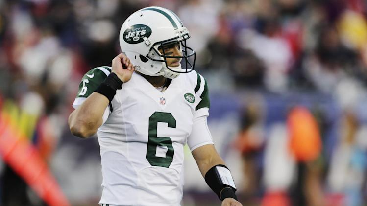 New York Jets quarterback Mark Sanchez walks off the field after throwing an interception to New England Patriots cornerback Alfonzo Dennard in the second quarter of an NFL football game in Foxborough, Mass., Sunday, Oct. 21, 2012. (AP Photo/Charles Krupa)