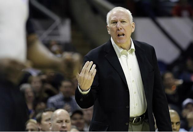 San Antonio Spurs head coach Gregg Popovich talks to an official during the first half of a preseason NBA basketball game against the Orlando Magic, Tuesday, Oct. 22, 2013, in San Antonio