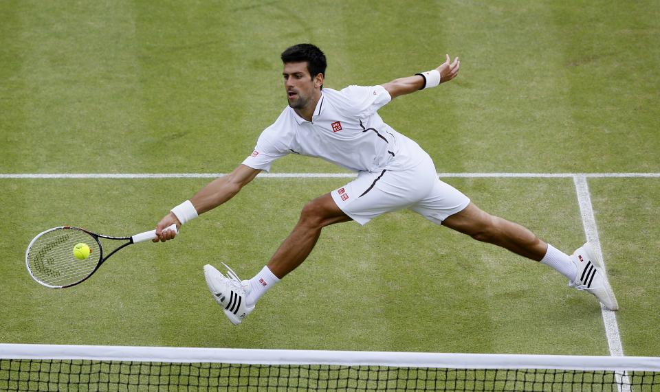 Novak Djokovic of Serbia returns to Tomas Berdych of the Czech Republic during a Men's singles quarterfinal match at the All England Lawn Tennis Championships in Wimbledon, London, Wednesday, July 3, 2013. (AP Photo/Kirsty Wigglesworth)