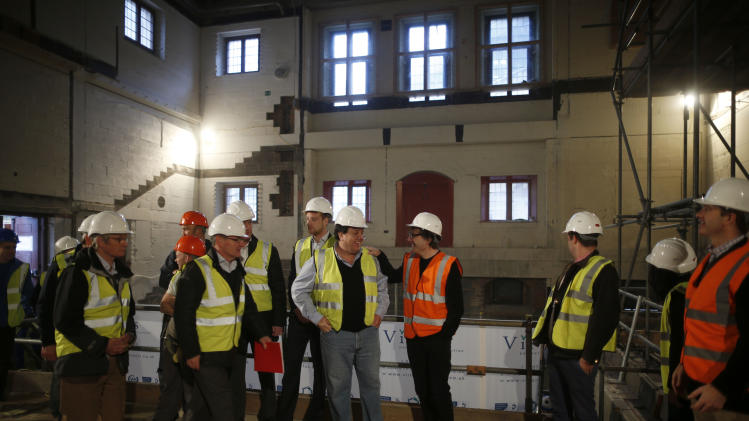 Members of the team behind the new indoor venue at Shakespeare's Globe gather to pose for a group photograph for the media during a publicity event in London, Tuesday, Nov. 27, 2012. The new venue is named the Sam Wanamaker Theatre after the late American actor-director who spent decades realizing his dream of rebuilding Shakespeare's playhouse. It is due to open in January 2014, and will allow the Globe to hold performances year-round. (AP Photo/Matt Dunham)
