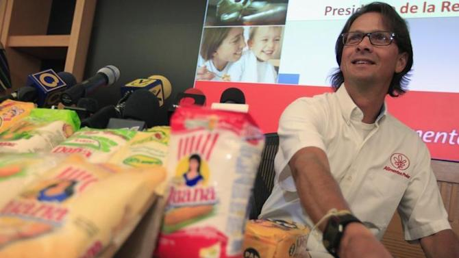 Mendoza, owner of Venezuela's largest private food production company Empresas Polar, attends a news conference in Caracas