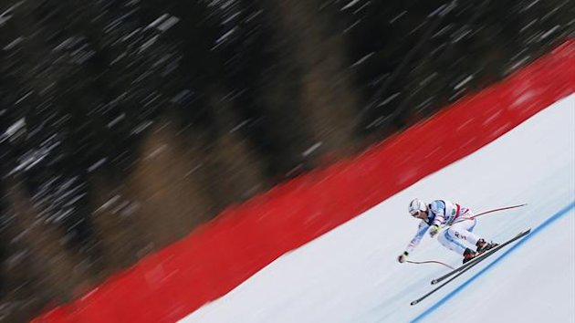 Romed Baumann of Austria skis during the men's super combined Downhill race at the World Alpine Skiing Championships in Schladming February 11, 2013. (Reuters)