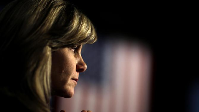 An audience member watches as Republican presidential candidate, former Massachusetts Gov. Mitt Romney speaks at a campaign event at the Red Rocks Amphitheatre Tuesday, Oct. 23, 2012, in Golden, Colo. (AP Photo/David Goldman)