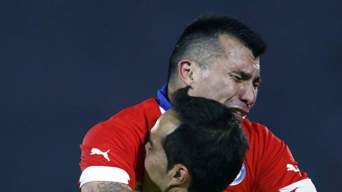 Chile's Gary Medel and Chile's goalie Claudio Bravo to celebrate defeating Argentina to win the Copa America 2015 final soccer match at the National Stadium in Santiago