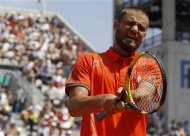 Youzhny of Russia reacts during his match against Ferrer of Spain during the French Open tennis tournament at the Roland Garros stadium in Paris