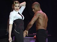 Madonna performs on stage during her 'MDNA' tour with dancer Brahim Zaibat in Tel Aviv, Israel on May 31, 2012 -- Getty Premium