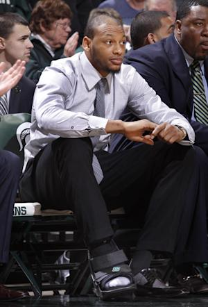 Michigan State's Payne sits against Northwestern