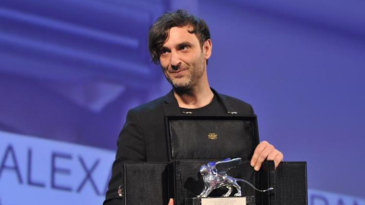 Greek director Alexandros Avranas poses with the Silver Lion for Best Director he received for his movie 'Miss Violence' during the award ceremony at the 70th Venice Film Festival, on September 7, 2013