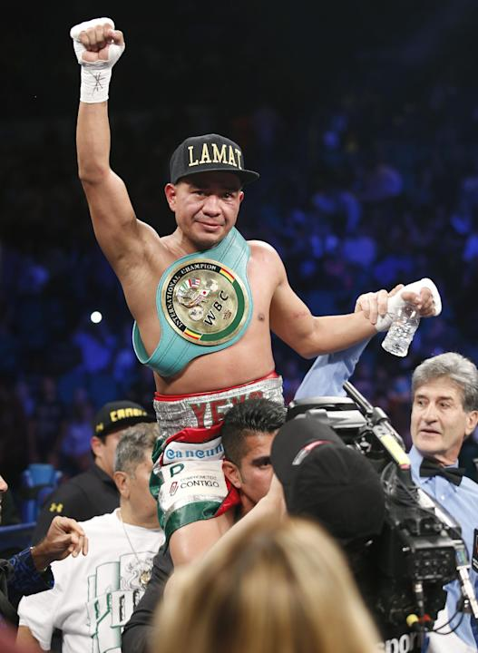 Sergio Thompson of Chetumal Mexico celebrates his unanimous decision victory over Ricardo Alvarez of Guadalajara Mexico just after their WBC lightweight boxing match, Saturday, March 8, 2014, at The M