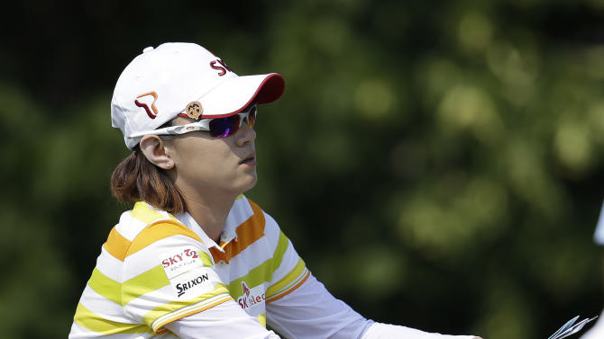 Na Yeon Choi, of South Korea, checks her notes before teeing off the sixth hole during the first round of the U.S. Women's Open golf tournament, Thursday, July 5, 2012, in Kohler, Wis. (AP Photo/Julie Jacobson)
