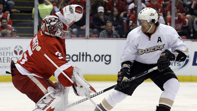 CORRECTS TO GAME 3, INSTEAD OF GAME 2 - Detroit Red Wings goalie Jimmy Howard (35) stops a shot by Anaheim Ducks' Teemu Selanne (8), of Finland, during the first period in Game 3 of a first-round NHL hockey Stanley Cup playoff series in Detroit, Saturday, May 4, 2013. (AP Photo/Paul Sancya)